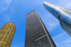 Three Towers. Chicago, USA - May 24, 2014: Looking up to three skyscrapers in a row. Marina City tower, Trump Tower and AMA Plaza in Downtown Chicago Royalty Free Stock Image