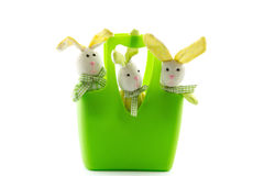 Three toy Easter Bunnies in a basket Royalty Free Stock Images