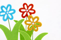 Three toy flowers Stock Photography