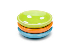Three toy plates. A stack of colorful toy plates on a white background Royalty Free Stock Photos