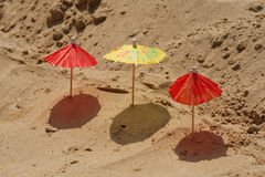 Three toy umbrella. Royalty Free Stock Photos