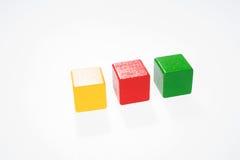 Three toys blocks, multicolor building bricks Stock Image