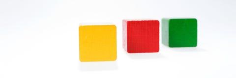 Three toys blocks, multicolor building bricks Stock Photography