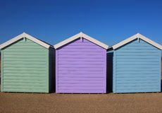 Three traditional beach huts with blue sky Stock Image