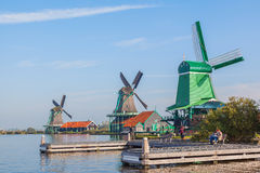 Three traditional dutch windmill beside the canal Royalty Free Stock Images