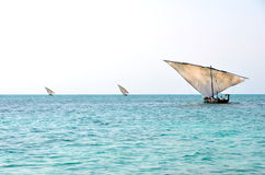 Three Traditional Fishing Boats Sailing. On the Ocean with Turquoise colored Water Royalty Free Stock Photography