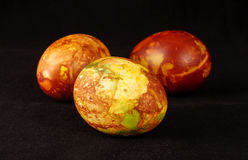 Three traditional painted Easter eggs on the dark background Royalty Free Stock Images