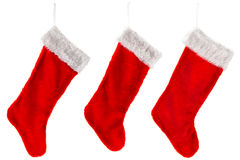 Three traditional red Christmas Stocking Royalty Free Stock Photos