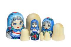 Three traditional Russian matryoshka dolls and blanks for painti. Painted matryoshka. Matryoshka  blue, blanks for painting dolls (clean matryoshka Royalty Free Stock Image