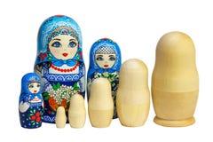 Three traditional Russian matryoshka dolls and blanks for painting dolls. Clean matryoshka. Painted matryoshka. Matryoshka  blue, blanks for painting dolls clean Royalty Free Stock Photos