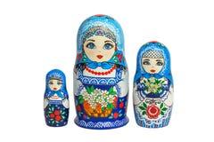 Three traditional Russian matryoshka dolls. Painted matryoshka. Matryoshka blue. 3 composite Stock Photo