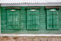 Three traditional russian wooden window in a wall Royalty Free Stock Image