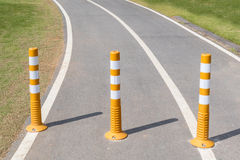 Three traffic poles on street, no entry for automobiles. Royalty Free Stock Image