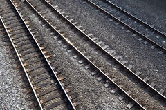 Three train tracks. With reflected sunlight Stock Image