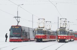 Three trams in Prague in heavy snowfall Stock Image