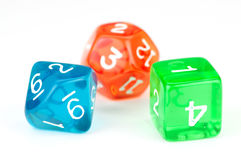 Three translucent, colored dice on white Royalty Free Stock Photos