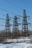 Three transmission electric towers with background of blue sky stock images