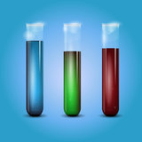 Three transparent test tubes with liquid Stock Photos