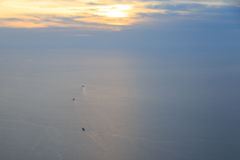 Three transport ships sailing in marmara seas near istanbul. With pastel colors Stock Image