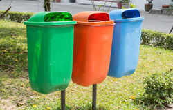 Three trash bin in different colors on a park Royalty Free Stock Photography