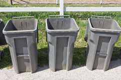 Three Trash Cans Royalty Free Stock Image