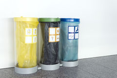 Three trash cans for recycling Stock Photo