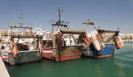 Three Trawlers in Garrucha Harbor and Marina Stock Image
