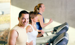 Three on the treadmill Royalty Free Stock Photo