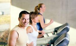 Three on the treadmill Royalty Free Stock Photo