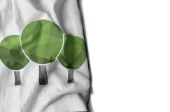 Three trees icon wrinkled flag, space for text Stock Images