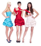 Three trendy girls in dresses Royalty Free Stock Images