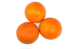 Three tropical and exotic, healthy oranges, isolated on a white background. An organic, fresh and bright orange vitamins. Royalty Free Stock Photo