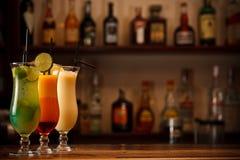 Three tropical mixed drinks stock photos