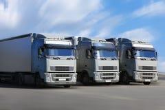 Three trucks go on  highway Royalty Free Stock Photo