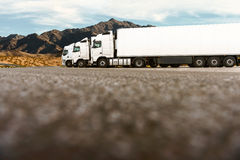Three trucks in a row of a transporting company stock images