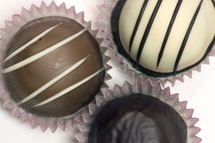 Three Truffles. A group of three different chocolate truffles stock photos