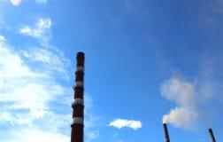 Three tubes Krasnoyarsk power plant against the sky Royalty Free Stock Photos