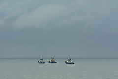 Three tug boats at sea. Royalty Free Stock Image
