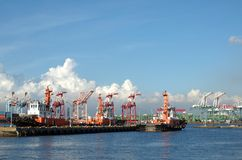 Three Tugboats in a Container Port Royalty Free Stock Images