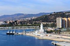 Three Tugboats at Lighthouse in Malaga Royalty Free Stock Photos