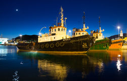 Three tugboats Stock Images