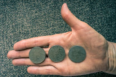 Three Tunisian coins on the woman's palm.  Royalty Free Stock Photos