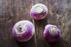 Three turnip on a vintage wood background Stock Image