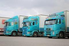 Three Turquoise Trailer Trucks Stock Photo