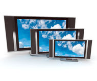 Three tv screens with a cloudscape royalty free stock image