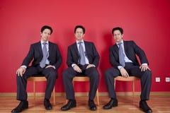 Three twin businessman waiting Royalty Free Stock Photo