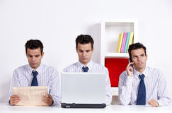 Three twin businessman working Stock Photos