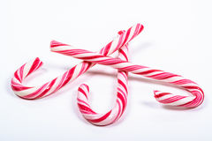 Three twisted red and white candy canes Stock Photo