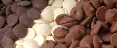 Three types of chocolate chips, dark, white and semi-sweet. Three types of chocolate pieces, white, dark and semisweet Royalty Free Stock Photos