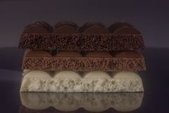 Three types of chocolate. Three types of porous chocolate. Three types of chocolate. Three bars of chocolate. porous chocolate. White chocolate. Milk chocolate royalty free stock image
